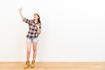 happy female student selfie using her mobile