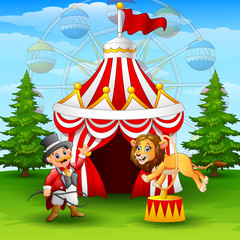 Cartoon lion jumping through ring on the circus tent background