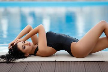 Beautiful woman in a sexy black bikini