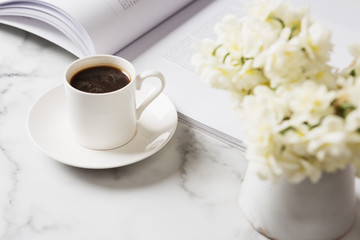 Beautiful white background of coffee and flowers horizontal