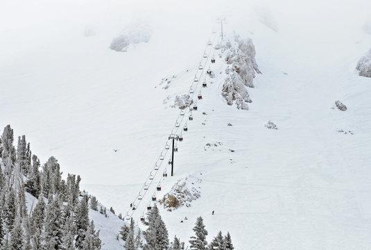 Ski lift chair ascending the mountainside
