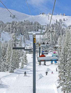 Winter ski lift riders