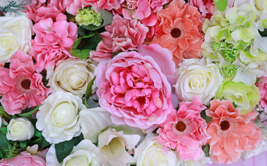 Artificial bouquet flowers background.