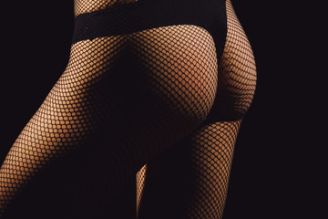 Ass wearing black fishnet pantyhose tights and panties