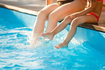 Children legs in the water splashing