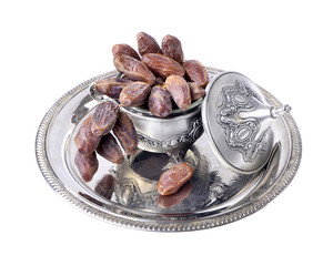Fresh fruit dates in a silver metal bowl on a  isolated  white background