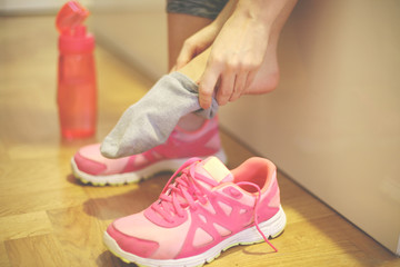 The girl is getting ready for exercise. The girl is wearing a sock. Close up.
