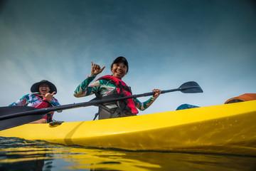 Two hawaiian girls on kayak