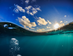 Sunset ocean world discovered, abstract marine underwater backgrounds with air bubbles for design