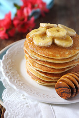 Banana pancakes with honey and caramelized bananas