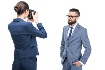 woman taking photo of handsome businessman, isolated on white