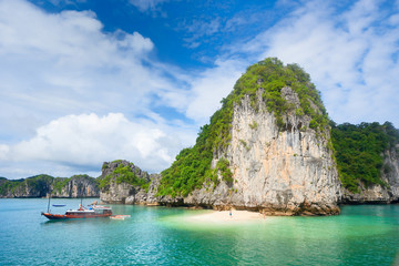 Beautiful scenery with an island and a wild beach in the archipelago Cat Ba, Vietnam.