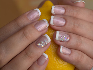 Lacquer on the nails of the hands. Fresh French manicure