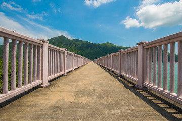 At the middle of road: Long Road with Pink railing