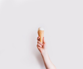 Ice cream in hand on a white background, minimalism