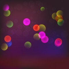 Abstract blurred background with bokeh effect and glowing colored spots.