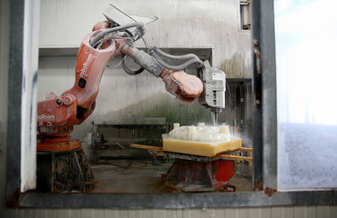 An ABB robotic arm is seen carving marble at the Henraux Company in Querceta, Tuscany
