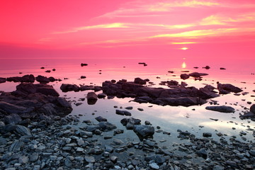 Spoed Fotobehang Candy roze Sundown at Rock coast, Lake Baikal, Russia