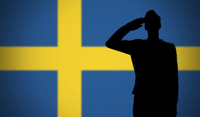 Silhouette of a soldier saluting against the sweden flag
