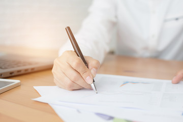 Businessman hands working with documents at the desk
