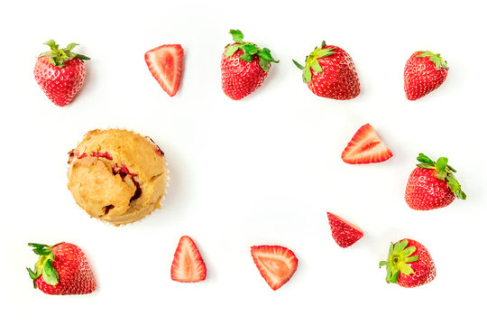 Strawberry muffin with fresh berries and copy space