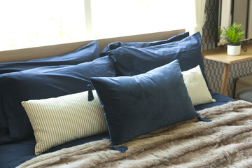 blue pillow on bed