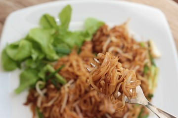 Fried noodle Thai style with pork is delicious