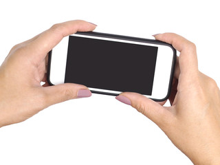 Woman two hands holding mobile phone and taking picture, isolated on white.