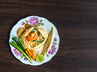 Fried Noodles wrapped with eggs Phad Thai