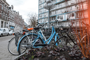 Many bicycles parked in a lockable area