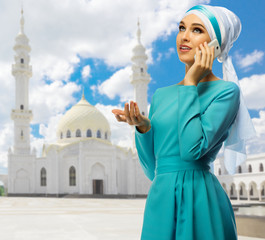 Muslim girl on white mosque background