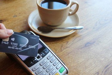 contactless payment card pdq coffee cafe background copy space with hand holding credit card to pay  stock, photo, photograph, picture, image