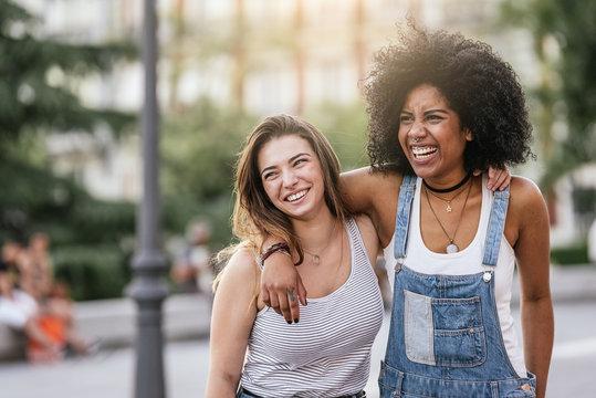 Beautiful women having fun in the street.