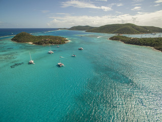 Sailboats rest in the clear waters near Prickly Pear Island in the British Virgin Islands.