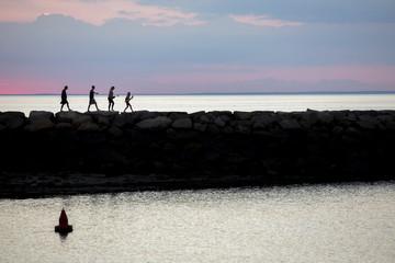 walking on jetty.