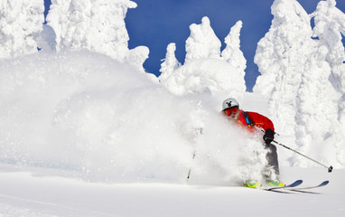 Male Skier Makes A Deep Powder Turn While Skiing In The Backcountry Near Whitefish, Montana