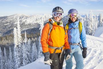 Portrait of backcountry skiers against winter landscape