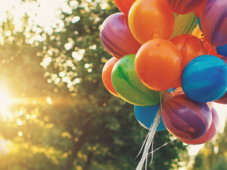 multicolor balloons against sunlight - concept image for happy birthday and wedding honeymoon party