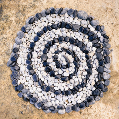 Spiral of black and white stones