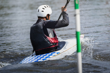 Kayak racer goes towards finish line during competition.