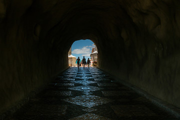 Perspective of claustrophobic underground walkway tunnel in Algarve Portugal, light at the end of the tunnel.