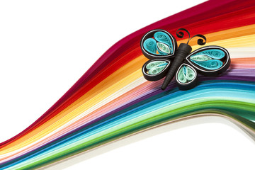 Quilling butterfly on rainbow