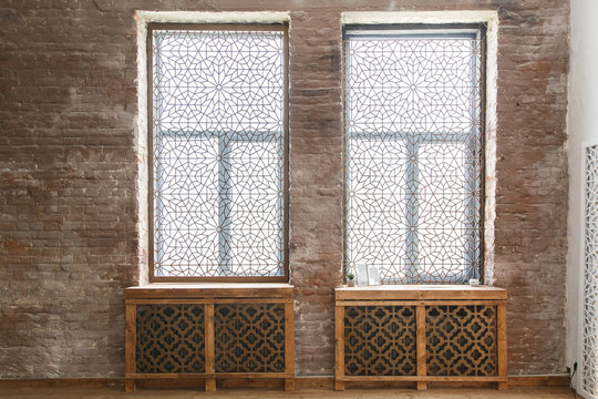 Arabic style room. Two windows with beautiful carving