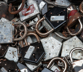 Old rusty locks and keys at flea market. Security, censorship or suppression concept.