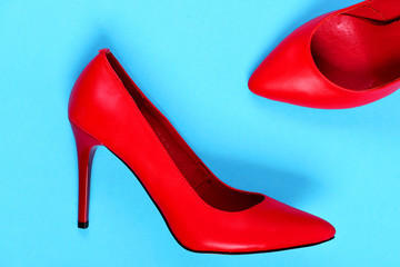 Fancy high heel red shoes isolated on blue background
