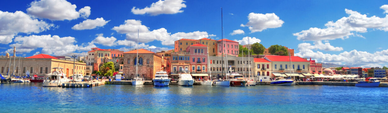 Colorful panoramic HDR image of the beautiful old Venetian Harbour of the city of Chania with boats and yachts on cloudy blue sky and turquoise water, Crete, Greece