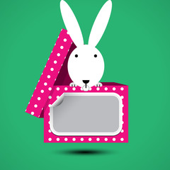 Rabbit sits in box for gift with sticker for your text. Vector illustration