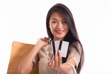 Happy Asian woman smile with shopping bags and looking in credit card,Isolated on white background