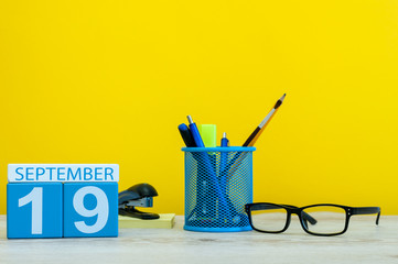 19th September. Image of september 19, calendar on yellow background with office supplies. Fall, autumn time