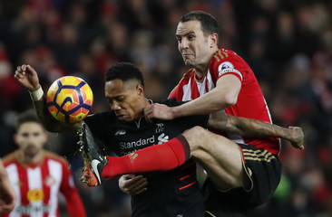 Liverpool's Nathaniel Clyne in action with Sunderland's John O'Shea